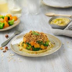 Crumble de carbassa i bròquil sobre hummus de cigrons